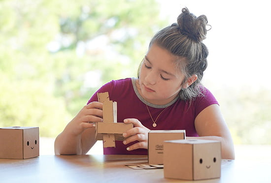 Girl assembling Chatterbox