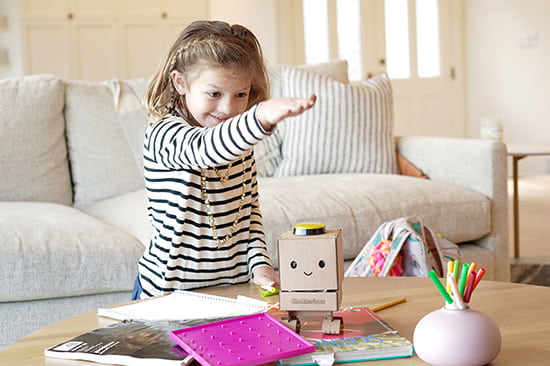 Girl playing with Chatterbox